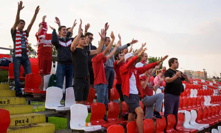 Fans chant during a game of Spartak's second team.