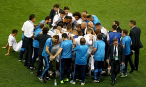 The Real Madrid players huddle before extra time.