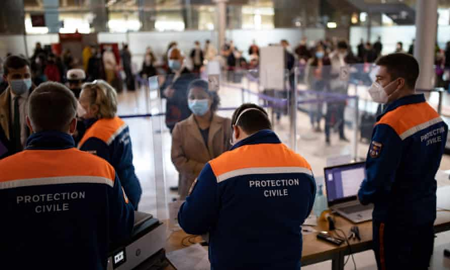 Passengers arriving at Roissy Charles de Gaulle airport near Paris in April register for Covid tests