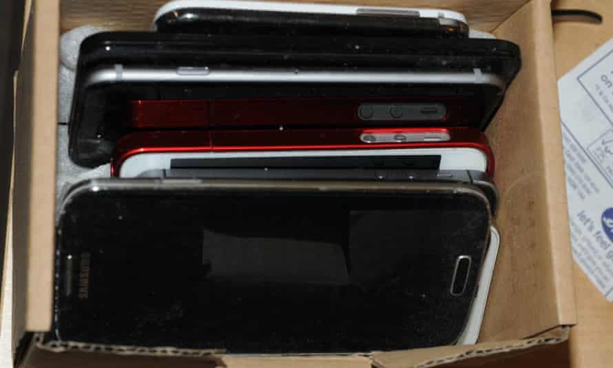 A collection of mobile phones taken by police as evidence in the Reynhard Sinaga case
