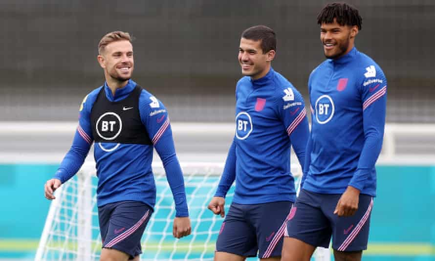 The England captain, Jordan Henderson (left), with Conor Coady (centre) and Tyrone Mings.