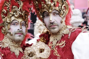 Venice, Italy: Masked attendees at the annual carnival