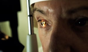 Closeup of man having an eye test
