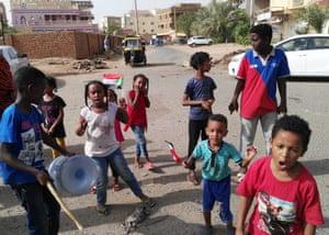 Sudanese children chant slogans in the streets of Khartoum
