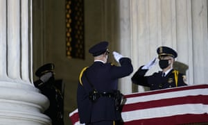 Supreme court honor guard moves the flag-draped casket of justice Ruth Bader Ginsburg back into the court as she lies in repose under the portico at the top of the front steps of the US supreme court building, in Washington.