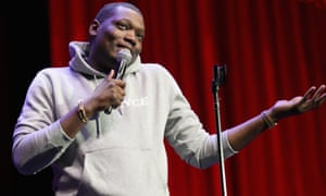 Michael Che on stage at a comedy festival