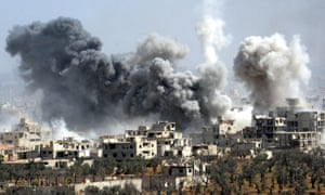 Smoke billows in Douma, where civilians were killed by a chemical attack at the weekend.