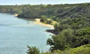 The public Pilaa Beach, below the hillside and ridgetop land owned by Facebook CEO Mark Zuckerberg.