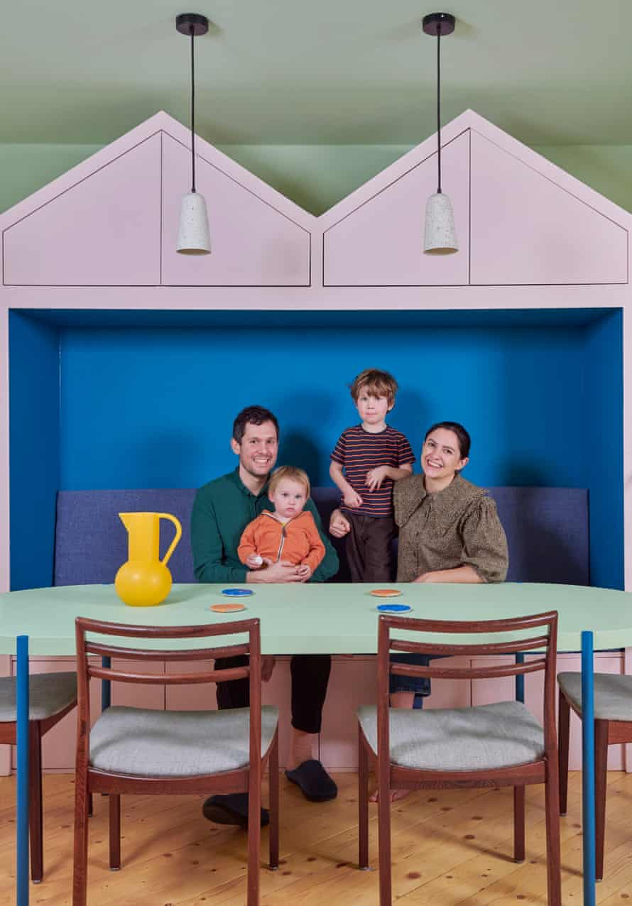 Tamsin Chislett, partner Max Lines and children Mo and Marcie Chislett in their brightly coloured kitchen