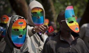 Kenyan protesters wear masks during a rally against Uganda's laws on LGBT rights.