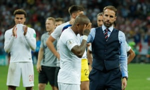 Gareth Southgate consoles Ashley Young on the pitch after England's exit from the World Cup