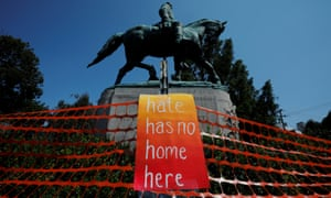 A monument to Confederate general Robert E Lee is adorned with an anti-hate sign.