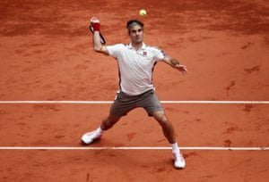 Roger Federer focusses on the ball as he readies a return.