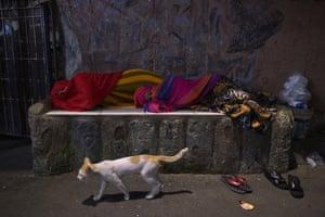 Women sleeping on the street at night.
