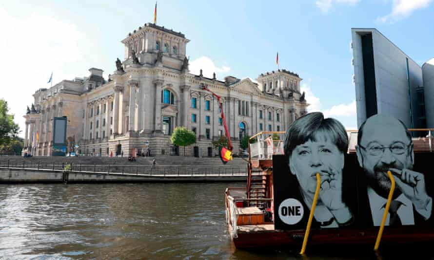 A boat with a placard featuring the German chancellor, Angela Merkel, and SPD leader, Martin Schulz, passes the Bundestag in September.