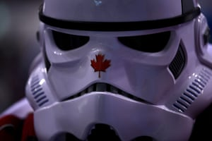 A Canada fan wears a Star Wars Stormtrooper mask during the women's preliminary round ice hockey match against the USA