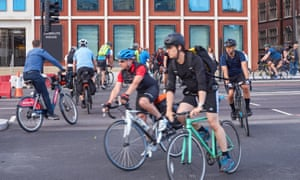 Cyclists on a cycle superhighway near Blackfriars Bridge, London