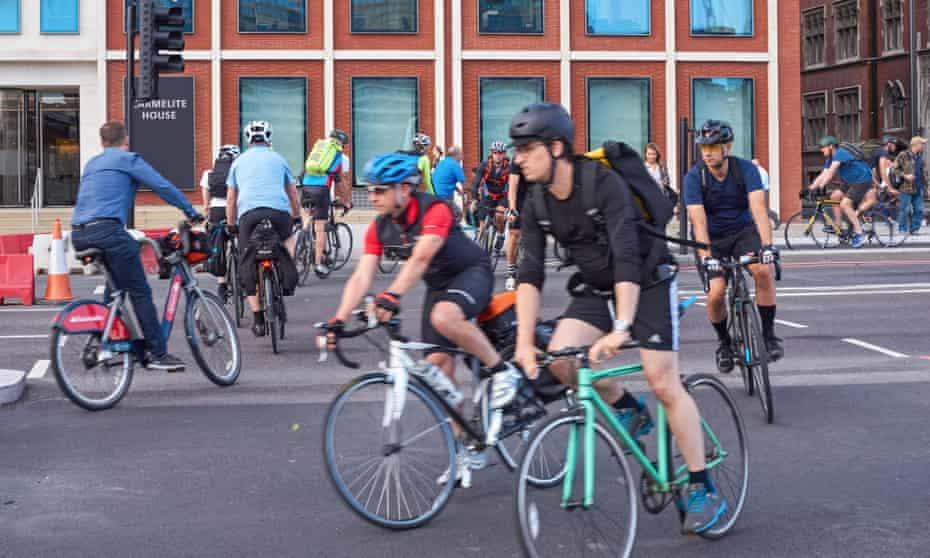 Cyclists on a cycle superhighway near Blackfriars Bridge, London