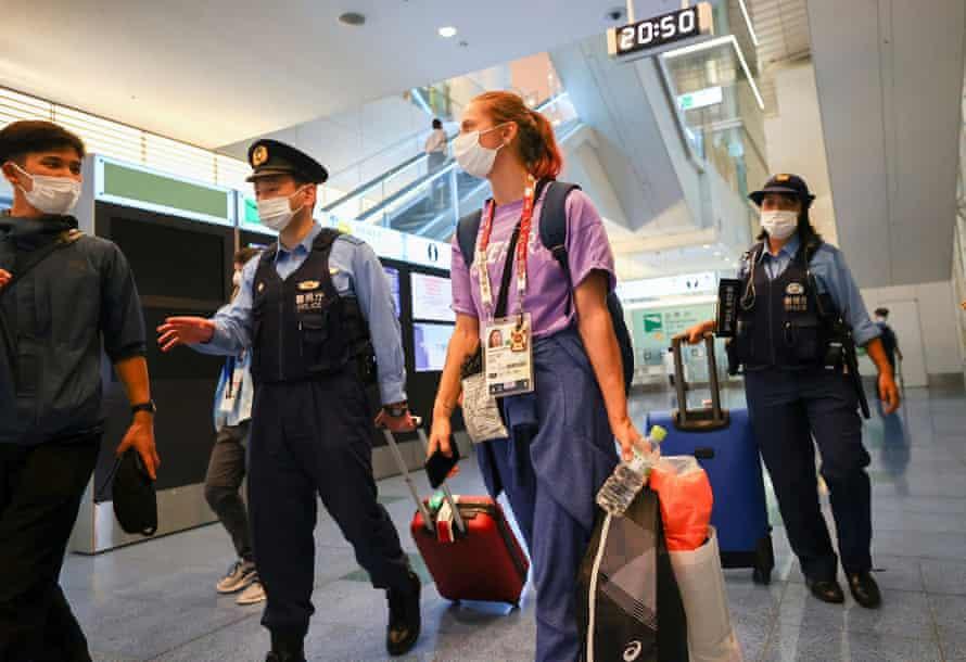 Krystsina Tsimanouskaya escorted by police