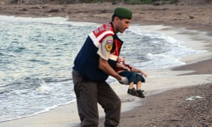 One of the photographs of Alan Kurdi that appeared in newspapers on 2 September.
