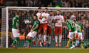 Conor Hourihane (17) curls his free-kick around the Georgia wall to give Ireland the lead.