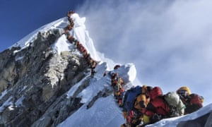 Climbers wait to make their final ascent to the peak of Mount Everest.