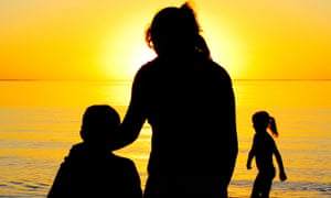 Woman with two children at the beach