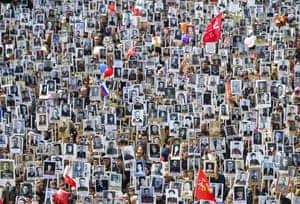 Participants in Vladivostok hold portraits of their relatives