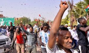 Demonstrators in Khartoum celebrate Bashir's departure on Thursday.