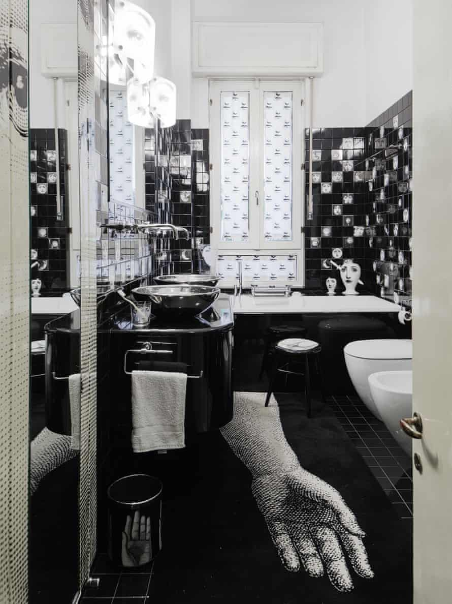 The family muse: the bathroom features many faces of Lina Cavalieri.