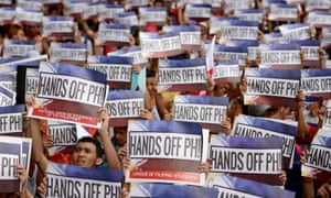 Activists in front of the Chinese consular office in Manila in June shouting slogans against China's reclamation and construction activities on islands and reefs in the Spratly Group of the South China Sea that are also claimed by the Philippines.