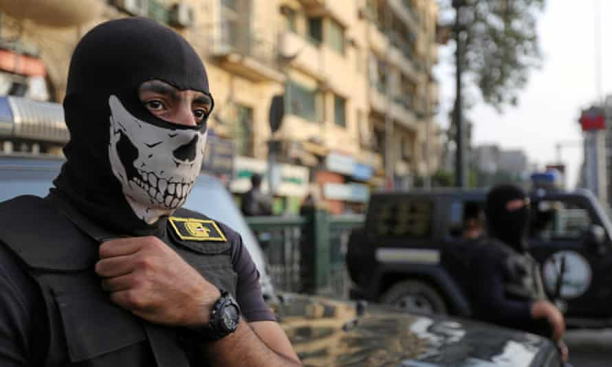 A masked member of the security forces in Tahrir Square in Cairo, Egypt, in November 2016. The HRW report says the security forces routinely use torture to force suspects to confess, or to punish them.