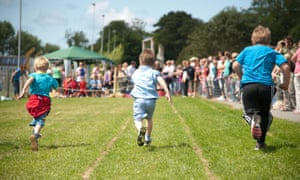 Young boys racing at the annual school sports day.