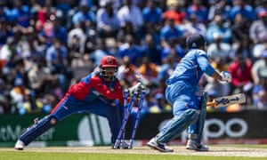 MS Dhoni of India is stumped by wicketkeeper Ikram Ali Khil of Afghanistan.