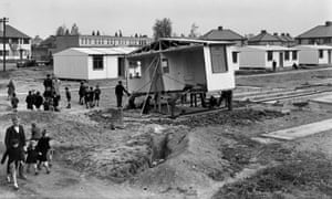 Schoolchildren helping the workmen construct a new estate of pre-fabricated houses in Watford, Hertfordshire after the second world war.