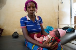 Zoenabo Karane, 33, holds her fifth child at Kampoaga village health centre in Burkina Faso