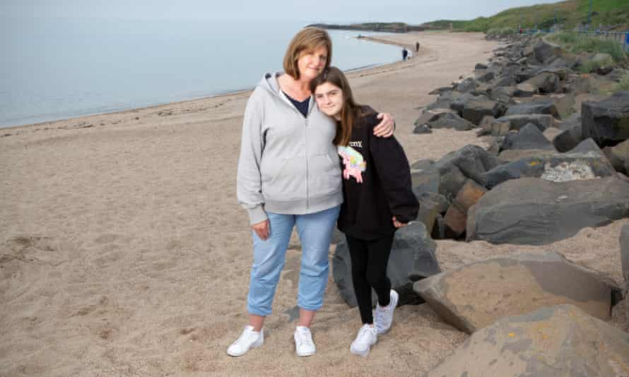 Claire Hayes and her daughter Gracie, 11, near their home in Newbiggin-by-the-Sea in Northumberland. Gracie has been suffering from Long Covid.