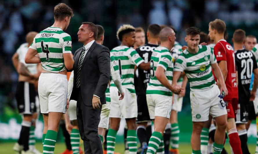 Celtic manager Brendan Rodgers talks with Jack Hendry after a Champions League qualifier.