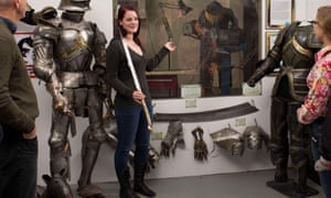 Visitors see props and costumes at the Weta workshop.