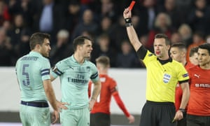 The referee, Ivan Kruzliak, gives Arsenal's Sokratis Papastathopoulos his marching orders just before half-time.