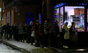 People queue to vote at a polling station in south-west London