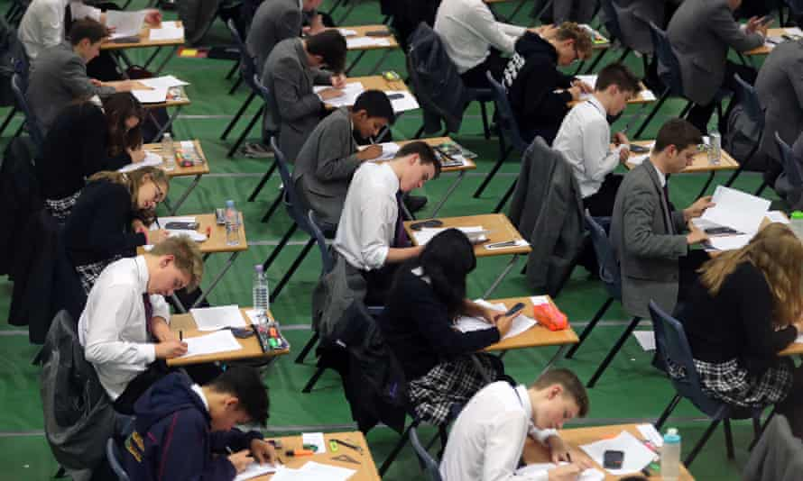 Students sitting a GCSE exam, which will now be graded using a 9-1 system rather than A* to G.