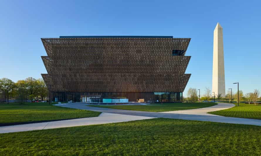 The National Museum of African American History and Culture flanked by the Washington monument, right.