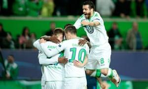Maximilian Arnold, left, of Wolfsburg celebrates with his team-mates scoring his team's second goal.