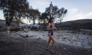Nevaeh Porter, 8, cries after viewing the remains of her home that was destroyed by a wildfire near Ashcroft, British Columbia Sunday.