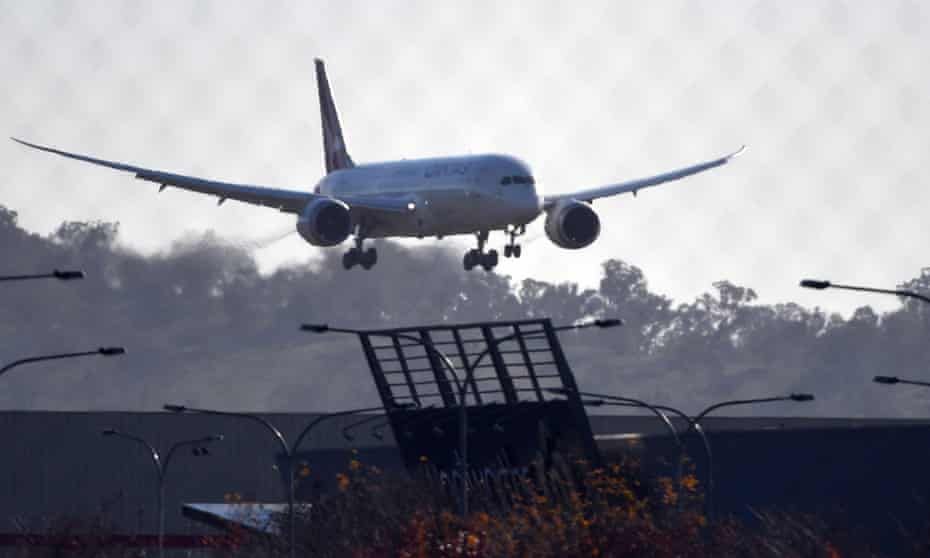 A Qantas flight carrying Australians who were stranded in India lands at Canberra airport