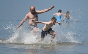 People enjoy the hot Bank Holiday weather on a beach in Margate.