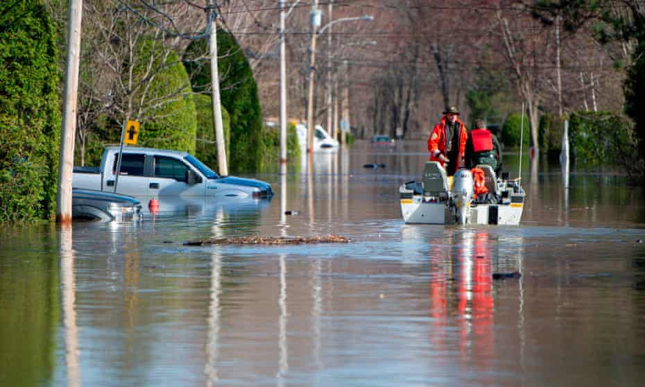 Canadian police in a flooded street in Sainte-Marthe-sur-le-Lac in the suburbs of Montreal. Experts say the floods show Canada has not done enough to prepare for such disasters.