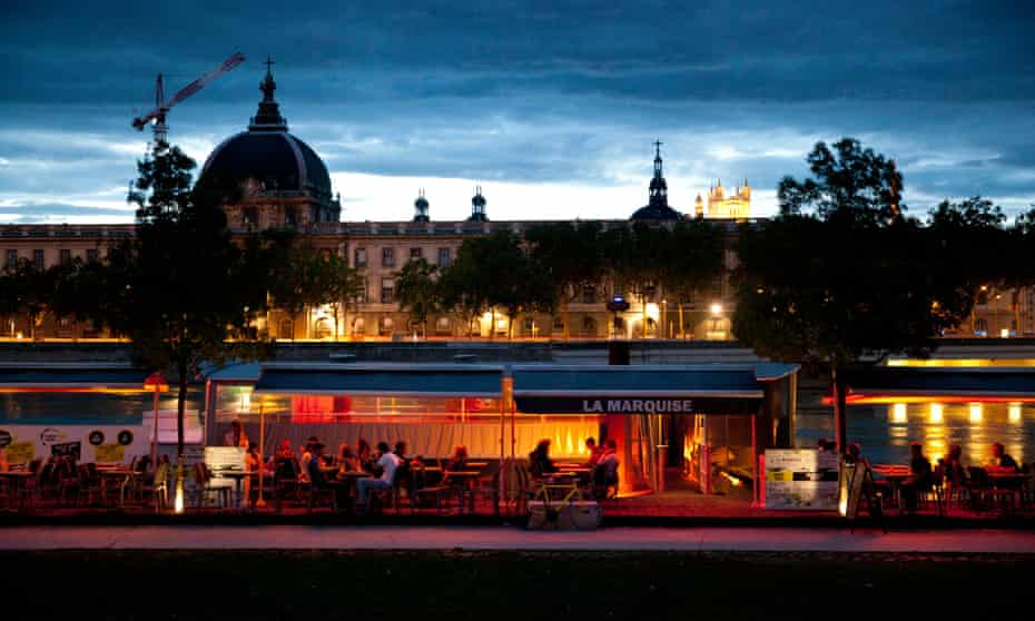 Lyon's youth gathers along the Rhone to drink on the numerous barges