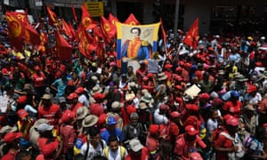 Supporters of Maduro display an image of the South American liberator Simon Bolivar during a May Day rally in Caracas on 1 May 2019.